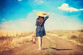stock photo of country girl  - Girl with lamp on country side road - JPG