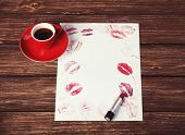 foto of lipstick  - Cup of coffee and lipstick on the wooden background - JPG