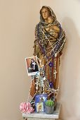 picture of rosary  - a statuette of the Virgin Mary with rosaries and holy pictures - JPG