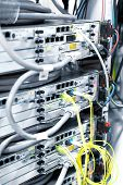 stock photo of telecommunications equipment  - Telecommunication equipment in a big datacenter. Close-Up. ** Note: Soft Focus at 100%, best at smaller sizes - JPG