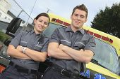 stock photo of paramedic  - Paramedic employee with ambulance in the background - JPG