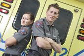 pic of paramedic  - Paramedic employee with ambulance in the background - JPG