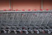 pic of trolley  - Long row of shopping trolleys of large supermarket - JPG