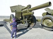 picture of exposition  - The child on an exposition of the Soviet weapon of times of World War II - JPG