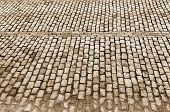 foto of paving stone  - Urban road is paved with blocks of stone cobblestone walkway sepia - JPG