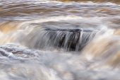 picture of cataracts  - Whitewater rages over rock leges and boulders in Indiana - JPG