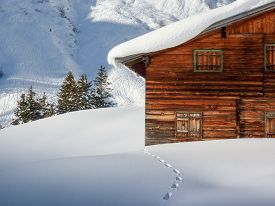 foto of track home  - Snow track to the ski lodge in the Austrian Alps - JPG