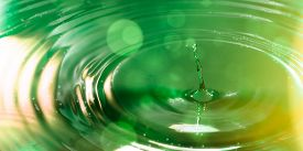 image of groundwater  - a single drop of water in naturally green design - JPG
