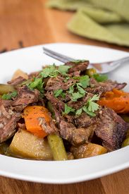 pic of pot roast  - braised beef pot roast stew with vegetables on table - JPG