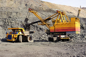 pic of iron ore  - Loading and export of iron ore in career by open way by means of dredges and lorries - JPG