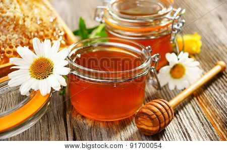 Honey In Jar, Stick, Honeycombs And Flowers, Food Photo