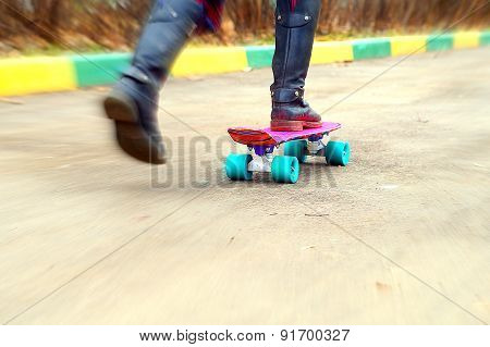 Young girl on skateboard in schoolyard