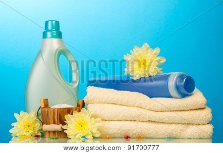 Detergent in bottles and towels