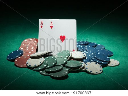 Poker chips and ace cards