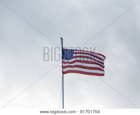 American Flag Flying Under Overcast Sky