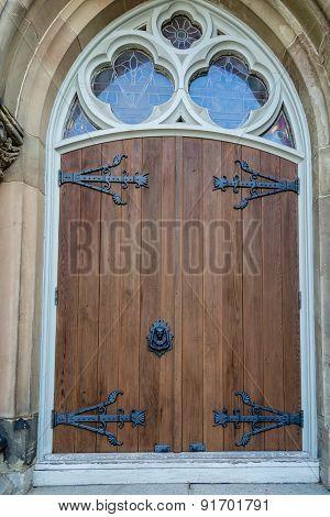 Old Wood Door With Black Iron Trim