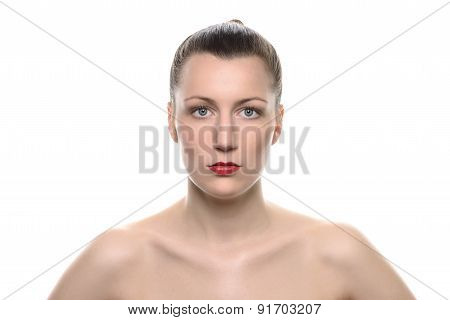 Strict Bare Woman Staring At Camera Against White