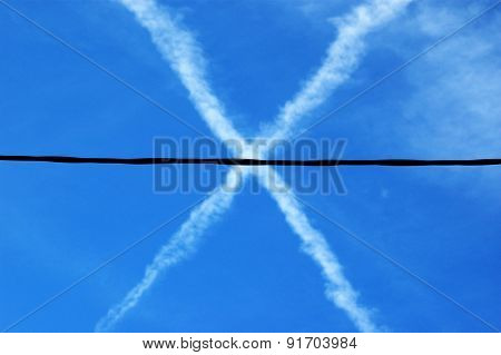 x, across traces of planes in the sky and wire of the power line