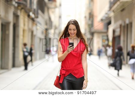 Fashion Woman Walking And Using A Smart Phone