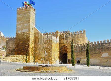 Seville gate alcazar with a fountain