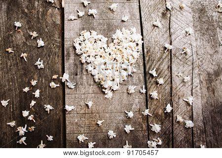 Gentle White Heart Shape Flowers On Wood Table