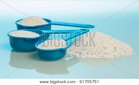 Washing powder and measuring containers