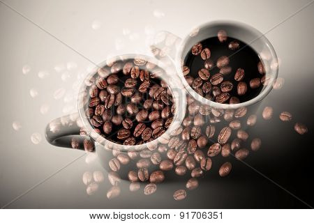 Coffee Cups Stand On A Table Over Coffee Beans