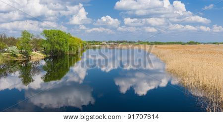 Spring panoramic landscape with river Oril