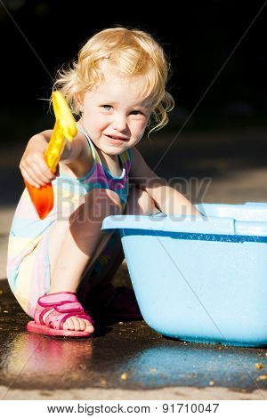 toddler girl playing in summer