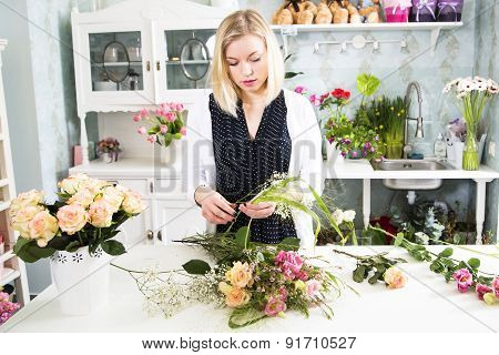 Florist With The Variety Of Details For The Floral Composition