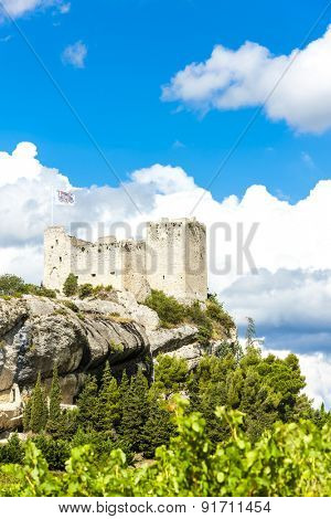 ruins of castle in Vaison-la-Romaine with vineyard, Provence, France