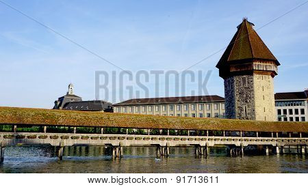 Historical Wooden Chapel Bridge And Tower In Lucerne