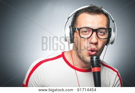 Guy With Microphone And Headphones