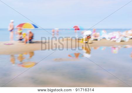 Vacationers At The Weekend On The Summer Beach. Blurry