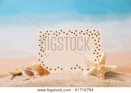 Blank card in sand