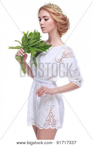 Beautiful sexual blonde  in white clothes with the basket of flowers isolated on a white background