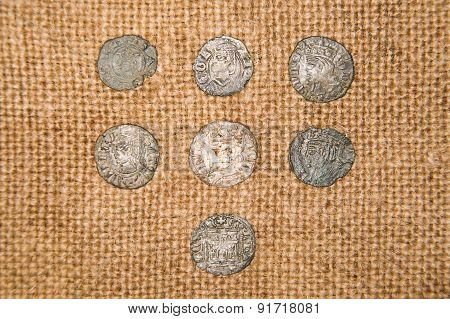 Vintage Silver Coins With Portraits On The Old Cloth
