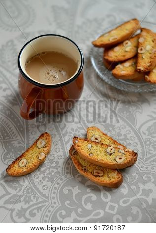 Cantucci Hazelnut And A Cup Of Coffee On A Grey Surface In Vintage Style