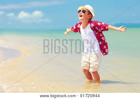 Happy Fashionable Kid Boy Enjoys Life On Summer Beach