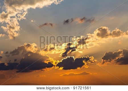 Clouds And Sky With Sun Ray Silhouetted On Evening