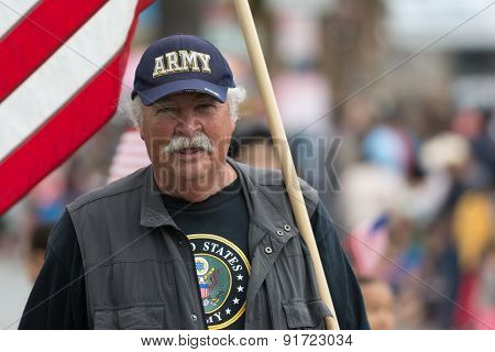 Military Veterans Holding Flag