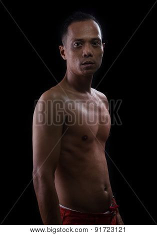 Portrait Face Of Young Asian Man Show Muscle On Arm And Chest With Studio Lighting Against Black Bac
