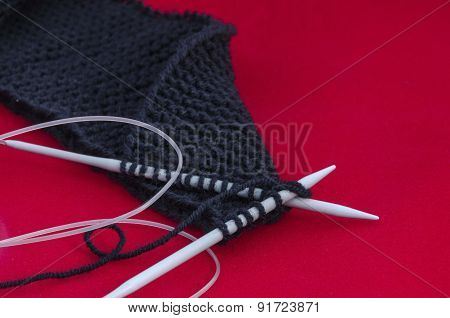 Hands knitting and knitting-needle