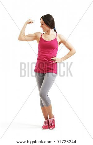 full length portrait of smiley woman showing her biceps. isolated on white background