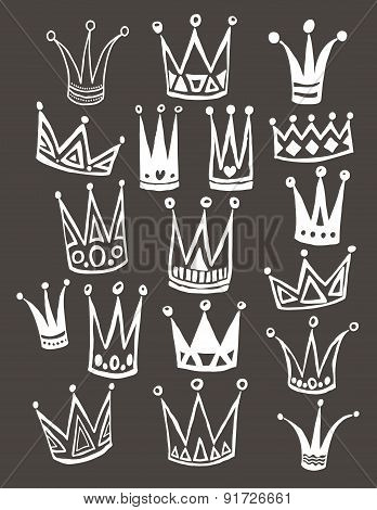 Set of cute cartoon crowns. Hand drawing vector background.  Vector illustration.