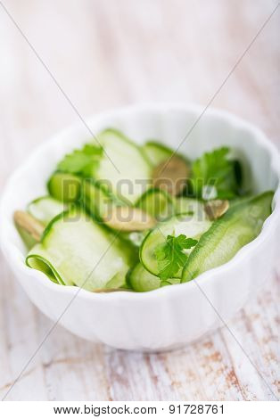 Salad With Fresh Cucumber, Pumpkin Seeds And Fresh Parsley