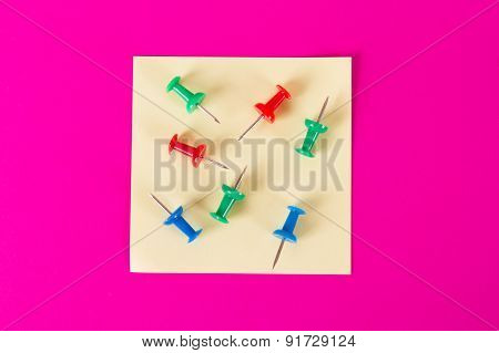 Sticky Post With Push Pins On Pink Background