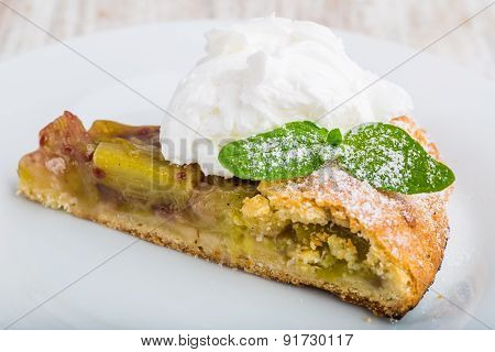 Piece Of Sweet Cake With Rhubarb And Whipped Cream