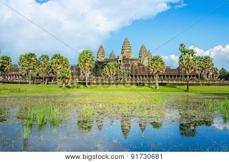 Angkor Wat Temple and palm trees with front lake