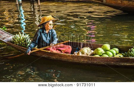 Old lady selling food on floating market, Thailand